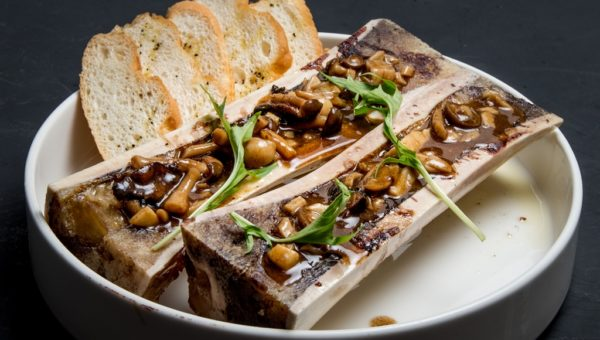 Roasted bone marrow with fried garlic, basil pesto and toast