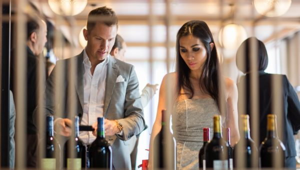 Guests exploring the wines exhibited at Po Restaurant, The Warehouse Hotel