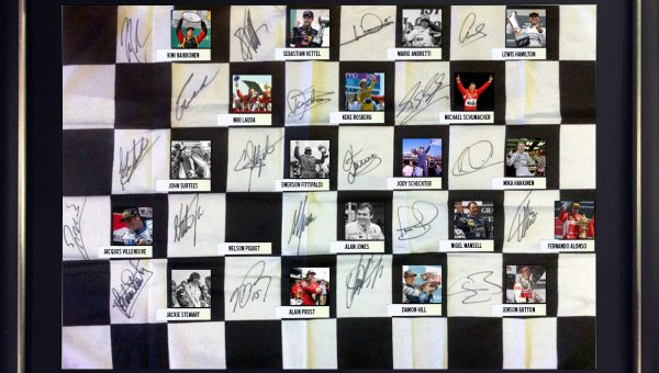 CHARITY AUCTION - FORMULA 1WORLD CHAMPIONS SIGNED CHEQUERED FLAG