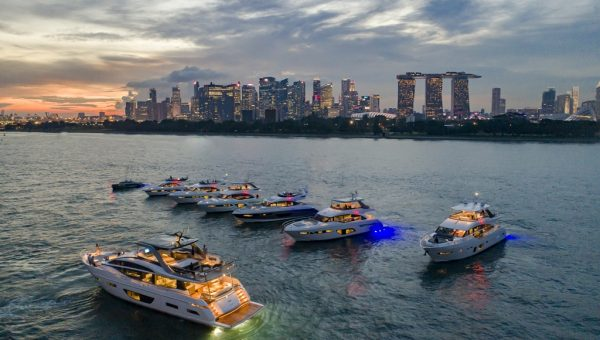 Princess Yachts Rendezvous- Princess Yachts rendezvous against the backdrop of Singapore's Central Business District skyline at sunset