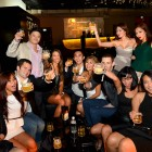 Party goers raise a toast at Johnnie Walker Circuit Lounge